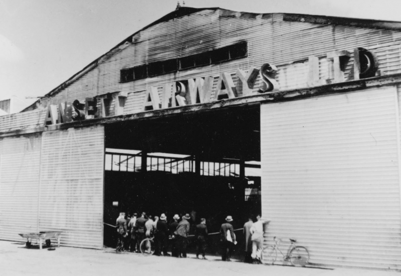 Click to enlarge. Photo supplied by CAHS of the Ansett Hangar after the fire on 28 February 1939
